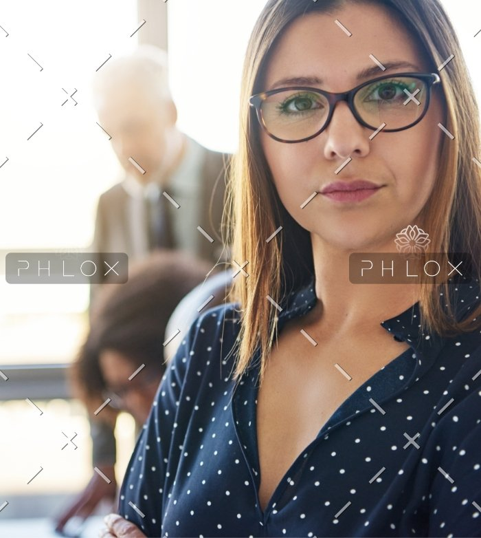 serious-business-woman-in-front-of-team-S8KCP9H