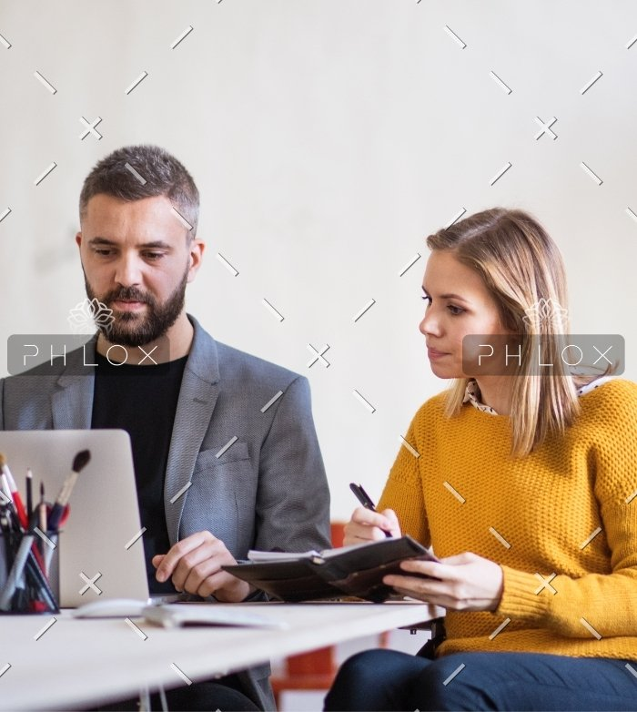 two-business-people-with-wheelchair-in-the-office-PMJT9V5